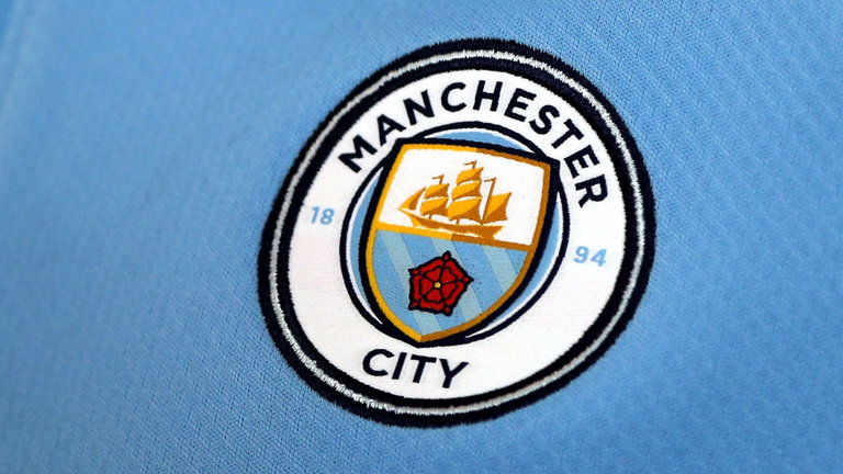New Manchester City Logo on Blue Kit