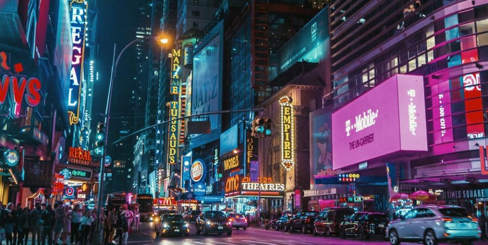American city at night with popular brands