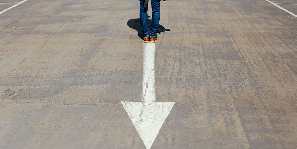 person standing on arrow