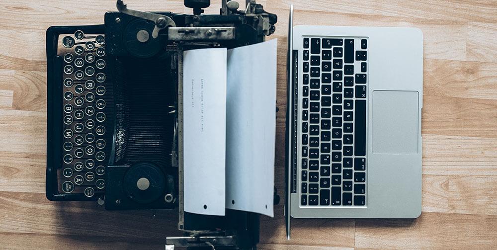 laptop and type writer