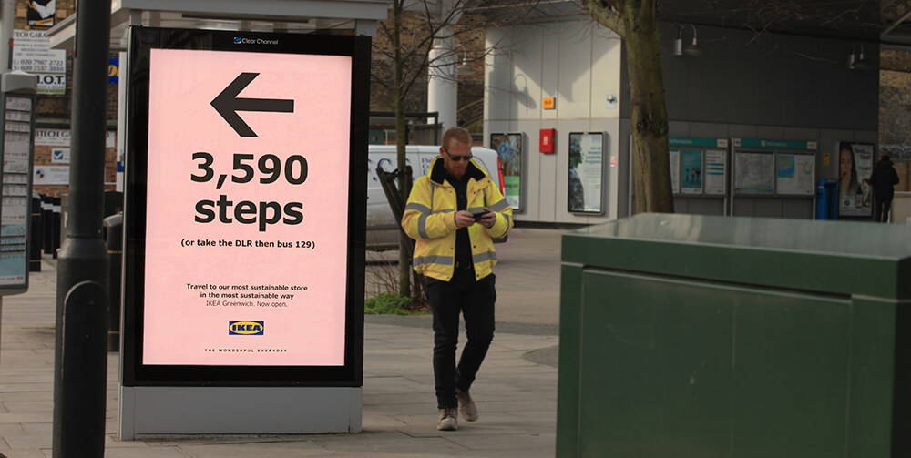 Ikea bus sign with man walking past