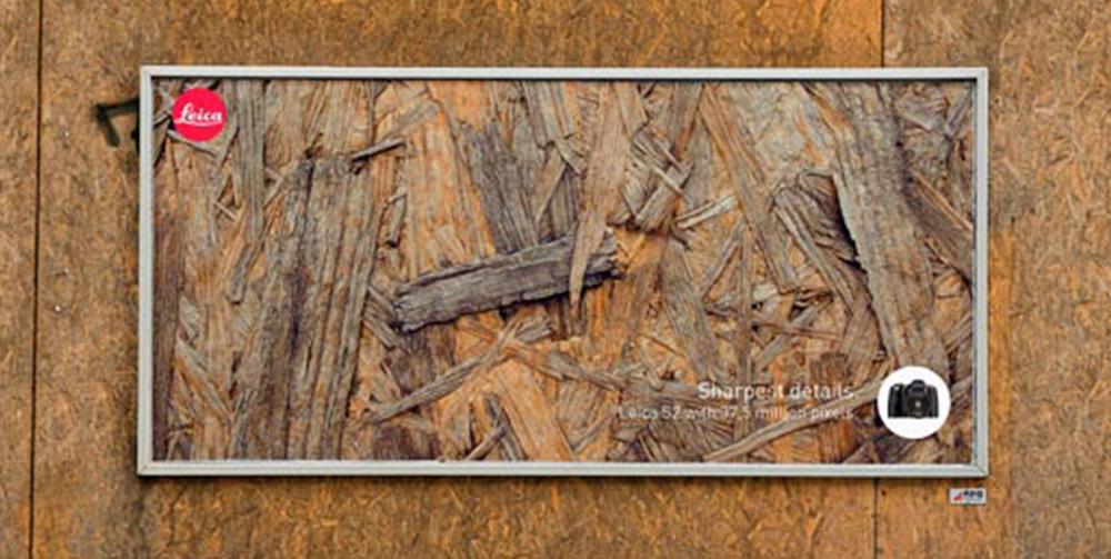 Wood wall with Leica billboard on