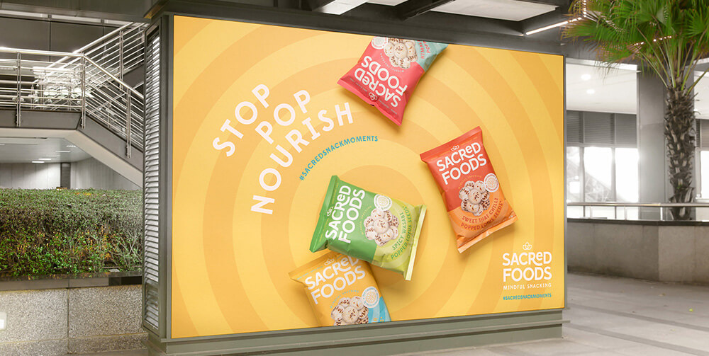 Bright orange billboard with snack packaging on